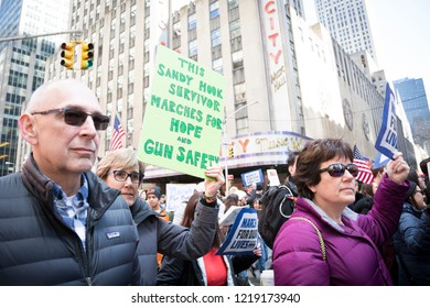 March For Our Lives: A woman holds a sign that says This Sandy Hook Survivor Marches For Hope and Gun Safety during the march to end gun violence on 6th Ave, NEW YORK MAR 24 2018.