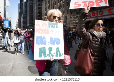 March For Our Lives: A woman holds a sign that says Im Not Afraid Of The Big Bad NRA during the march to end gun violence on 6th Ave, NEW YORK MAR 24 2018.