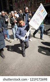 March For Our Lives: A young boy holds a sign that says More Learning Less Lockdown during the march to end gun violence on 6th Ave, NEW YORK MAR 24 2018.