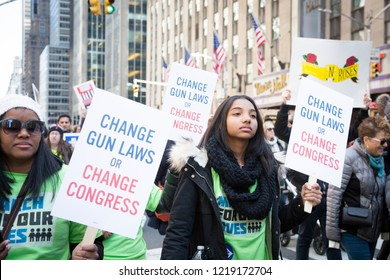March For Our Lives: Young marchers hold signs that say Change Gun Laws Or Change Congress during the march to end gun violence on 6th Ave, NEW YORK MAR 24 2018.