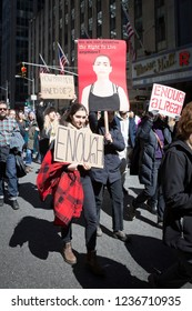 March For Our Lives: A young woman holds a sign with a portrait of Emma Gonzalez, a student at Marjory Stoneman Douglas High School, at the march to end gun violence, 6th Ave. NEW YORK MAR 24 2018.