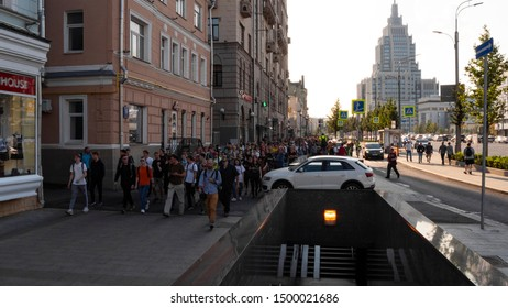 March of protest. Protest walks in the city center. A large crowd of protesters marching around the city chanting slogans for allowing candidates for the election. Moscow,Russia,AUGUST,31,2019.