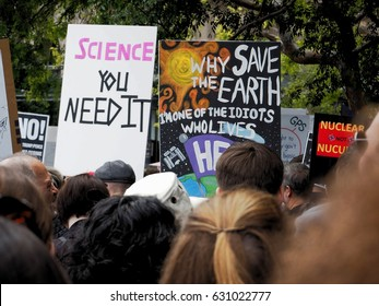 March for Science - San Francisco, CA - April 22, 2017. Thousands march against federal budget cuts to science research. One sign say 'Why save the earth. I am one of the idiots who lives here'