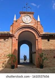 "MARCHE, RECANATI – SEPTEMBER 24, 2006: Cardinal Venieri palace balcony. It is surmounted by a clock with the inscription ""Volat irreparable Tempus"" (Time flies beyond repair)."