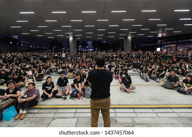 Marchers seat down and sing hallelujah at the government complex building  Protest against extradition to China bill in Hong kong. 2019 Jun 16th