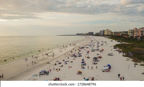 Marco Island, FL / United States - May 9th, 2020: Crowded public beaches on collier county, Naples and Marco Island on Saturday May 9th 2020 has prompted the city to issue a closure order for Sunday.