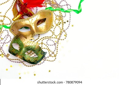 Mardi Gras background with masks, beads and copy space. Carnivale mask on a white background.