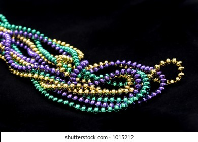 Mardi gras beads on black