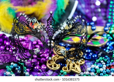 Mardi Gras Carnaval background - bright beautiful colors with mask and beads
