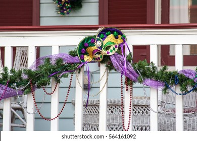 Mardi Gras decorations on white picket fence in Galveston, Texas