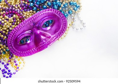 Mardi gras mask and colorful beads