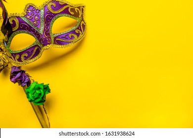Mardi Gras mask on a bright yellow background