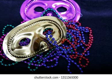 Mardi Gras masks with colorful beads