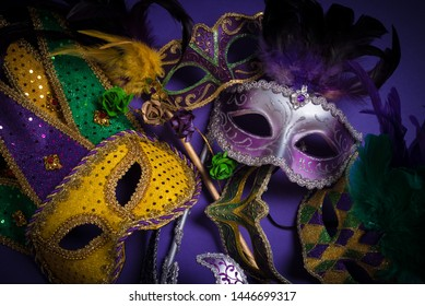 Mardi Gras masks on a dark background