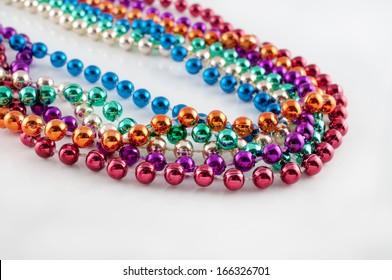 Mardi Gras necklaces on white