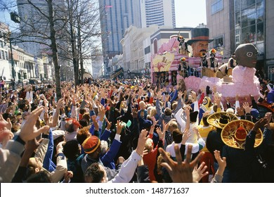 MARDI GRAS, NEW ORLEANS, LA - CIRCA 1990's: Crowd watching parade in New Orleans