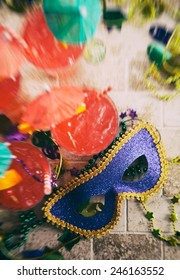Mardi Gras: Overhead Focus On Mask With Drinks And Trinkets