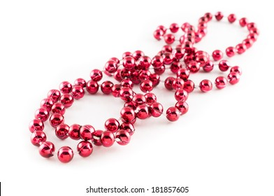 Mardi Gras party red beads placed in white background