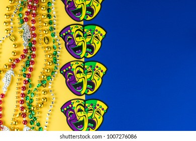 Mardi Gras symbol masks and beads on 2 bright color background. Copy space for invitation.
