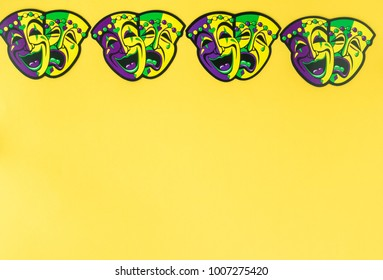 Mardi Gras symbol masks on 2 bright color background. Copy space for invitation.