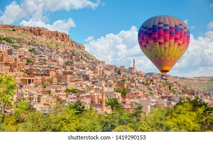 Mardin old town with bright blue sky - Mardin, Turkey - Hot air balloon flying over spectacular Old town of Mardin