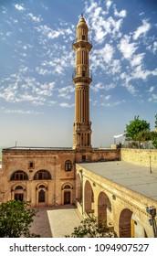 Mardin Sehidiye Mosque minaret with blue cloudy sky background - Mardin Turkey