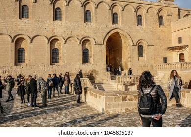 MARDIN, TURKEY - FEBRUARY 24: Tourists are visiting Deyrulzafaran Monastery in Mardin on February 24, 2018 in Mardin, Turkey.