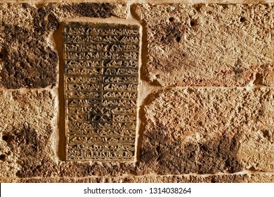 MARDIN, TURKEY — MAY 4, 2011. A stone tablet carved in Aramaic script lists the names of the patriarchs entombed at Deyrulzafaran Monastery in Eastern Anatolia.