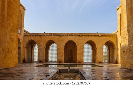 MARDIN- TURKEY-APRIL 09, 2021:The Kasimiye madrasa in Mardin is the center of attention for tourists. The madrasa has an extraordinary architectural structure.