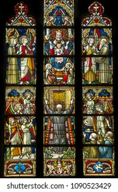 MAREDRET, BELGIUM – MAY 4, 2018: Stained glass window at Maredret Abbey Church, depicting the worship of mother Mary and her child Jesus.