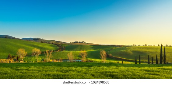 Maremma countryside, rolling hills, trees and small lake at sunset. Bibbona, Tuscany, Italy. Europe.