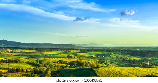 Maremma countryside, sunset landscape. Green fields and Elba island and sea on horizon. Tuscany, Italy, Europe.