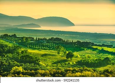 Maremma sunset panorama. Countryside, sea and Elba island on horizon. San Vincenzo, Tuscany, Italy.