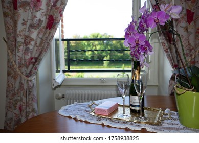 Mareuil-sur-Ay, Marne / France - July 24, 2016: View of a table with a bottle of Champagne and glasses in a room at the guest house of Guy Charbaut in Mareuil-sur-Ay in Champagne, France.