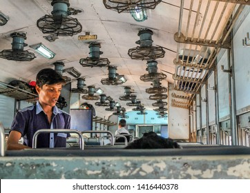 Margao,Goa,India-January 30th 2018: Food seller offers snacks to passengers on a 2nd class Indian rail carriage,travelling from Margao,Goa to Gokarna in Karnataka, India.