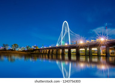 Margaret Hunt Hill Bridge at night  in Dallas, Texas,Margaret Hunt Hill Bridge and Dallas downtown skyline.