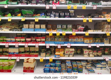 MARGARET RIVER, AUSTRALIA - JUNE 16, 2018: A refrigerator shelf selling dairy products made from milk (cheese) in Coles store. Coles is an Australian supermarket, retail and consumer services chain.