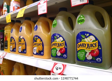 MARGARET RIVER, AUSTRALIA - JUNE 16, 2018:  Orange and mix fruits juice bottles on shelves in Coles supermarket. Coles is an Australian supermarket, retail and consumer services chain