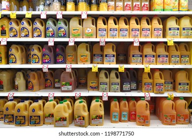 MARGARET RIVER, AUSTRALIA - JUNE 16, 2018:  Various brand orange juice bottles on shelves in Coles supermarket. Coles is an Australian supermarket, retail and consumer services chain.