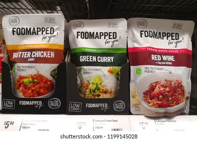 MARGARET RIVER, AUSTRALIA - JUNE 16, 2018: Various choice of Foodmapped brand cooking sauce on store shelf in Coles supermarket. Coles is an Australian supermarket, retail and consumer services chain.