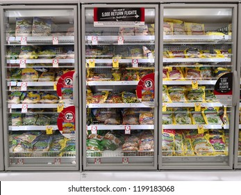 MARGARET RIVER, AUSTRALIA - JUNE 16, 2018: Interior view of huge glass freezer with various brand frozen foods in Coles store. Coles is an Australian supermarket, retail and consumer services chain.