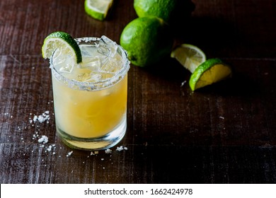 Margarita. Classic traditional Mexican cocktail. Made with Blanco tequila, fresh lime juice, agave syrup and orange juice. Served in salt rimmed tumbler over ice and garnished with a lime.
