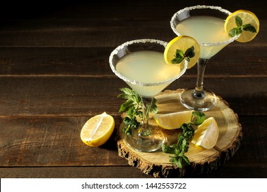 Margarita cocktail, Alcoholic drink, margarita cocktail with lemon and mint and salt on a wooden table. bar. bar stock and accessories.