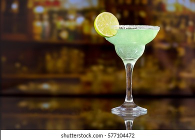margarita cocktail with lime in a bar