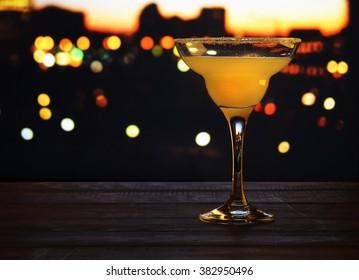 Margarita cocktail on blurred bokeh background