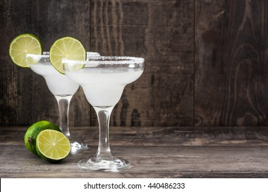Margarita cocktail on a rustic wooden background