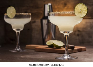 Margarita cocktail on a wooden background