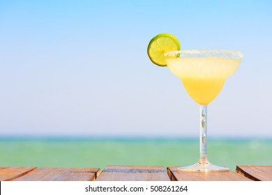 Margarita cocktail on the wooden pier. Concept of classic drink. Vacation background. Horizontal, zero level shoot. Shallow DOF