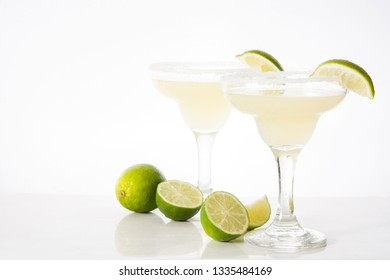 Margarita cocktails with lime in glass isolated on white background. Copyspace