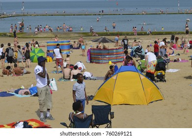 MARGATE, UK- AUGUST 28: Visitors flock to Margate Main Sands, voted one of the best beaches in Britain and enjoy the sunshine on the August Bank Holiday. August 28, 2017. Margate, Kent UK.
